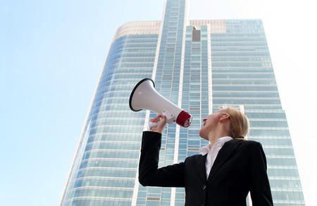 agitation: Businesswoman Using a Megaphone