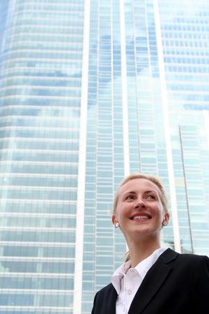 Businesswoman outside a modern office building
