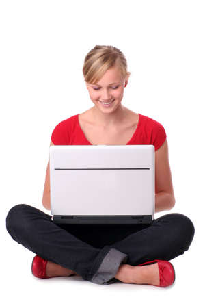 Young woman sitting on floor with laptop photo