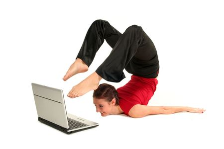bend over: Woman doing yoga with laptop