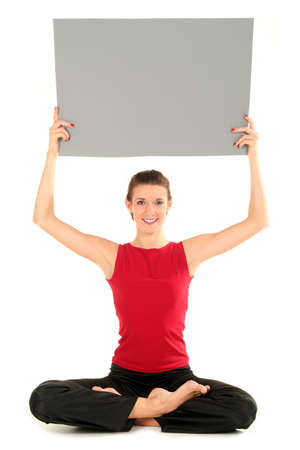 Woman with blank card doing yoga Stock Photo - 1933350
