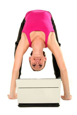 Woman bending over backwards and using laptop Stock Photo - 1933353