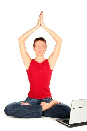 Woman with laptop doing yoga Stock Photo - 1942017