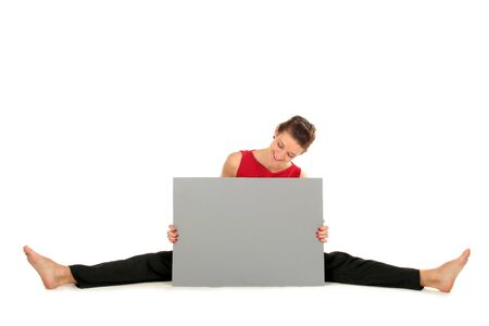 Woman with blank card doing a split Stock Photo - 1952420