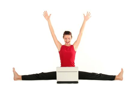 Woman doing a split and using laptop Stock Photo - 1960405