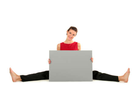 Woman with blank card doing a split Stock Photo