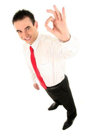 Businessman giving OK gesture (focus on hand) photo