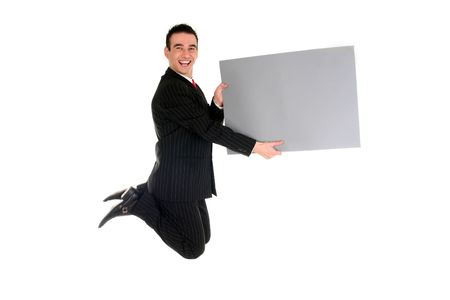 Businessman jumping with blank placard photo