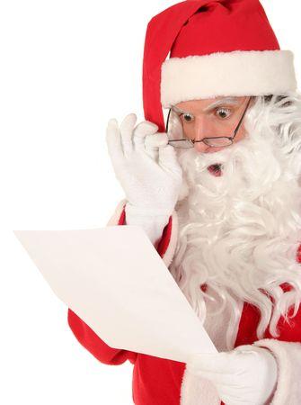 amazed: Santa Claus Reading Letter Stock Photo