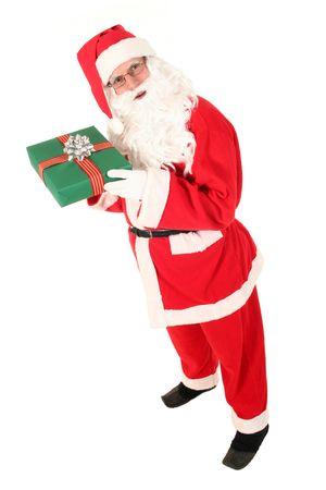 Santa Claus holding Christmas Gift photo