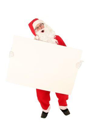Santa Claus holding blank billboard photo