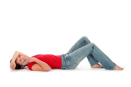 phonecall: Young woman lying down and talking on phone