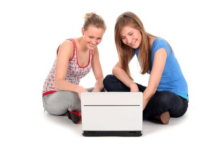 Young women using laptop photo
