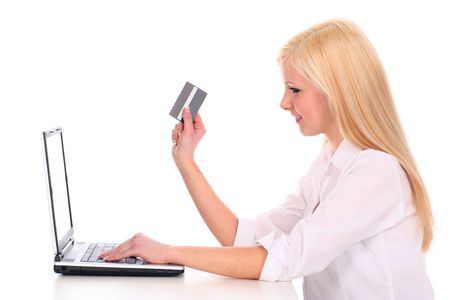 Woman using laptop, holding credit card  Stock Photo - 2455897