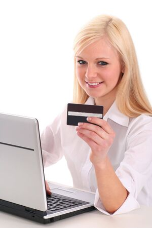 Woman using laptop, holding credit card  photo