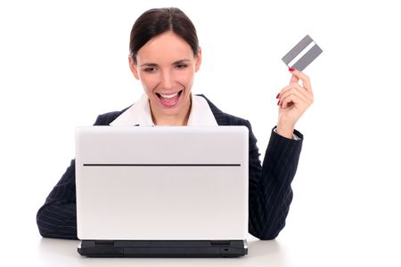 Woman using a laptop and credit card photo