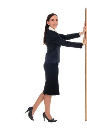 Businesswoman pushing something photo