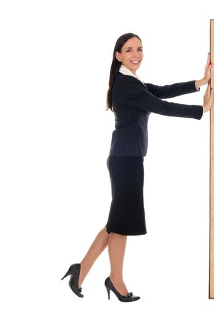Businesswoman pushing something photo
