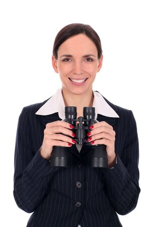 Businesswoman holding binoculars photo