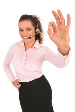 Businesswoman giving OK gesture  photo