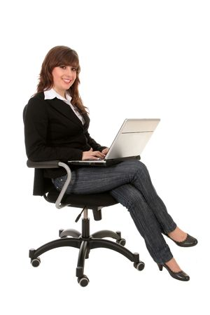 Businesswoman sitting in office chair with laptop  Stock Photo - 2731652