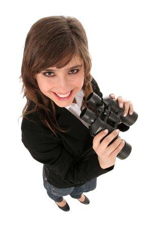 Businesswoman holding binoculars photo