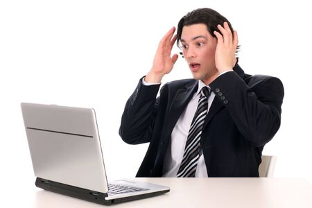 Businessman with laptop, holding head in hands Stock Photo - 2884039