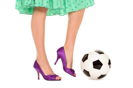 Soccer Ball and Women's Legs photo