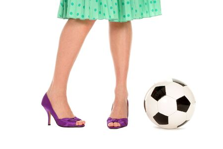 Soccer Ball and Women�s Legs photo
