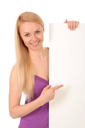 Beautiful young woman holding blank poster Stock Photo - 3129496