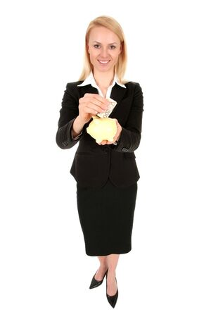 Businesswoman putting money in piggy bank photo