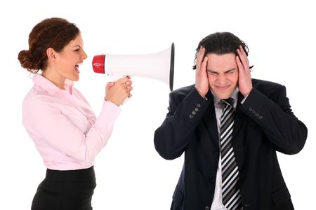 Businesswoman with megaphone yelling at businessman photo