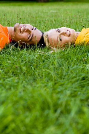 Couple Lying on the Grass photo