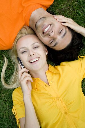 Couple talking on mobile phones photo
