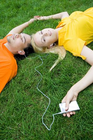 Couple listening to MP3 player Stock Photo - 3396654