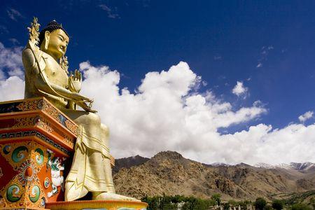 Buddha statue and Himalayas, Ladakh, India photo