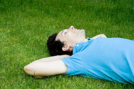 Young man lying on the grass Stock Photo - 3440589