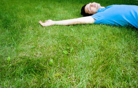 Young man lying on the grass  Stock Photo - 3441066