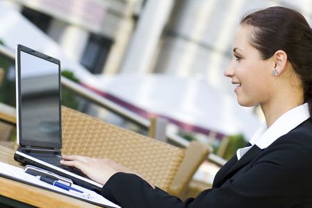Woman using laptop outdoors Stock Photo - 3453793