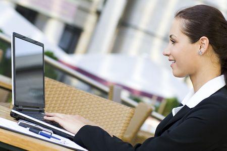 Woman using laptop outdoors Stock Photo - 3453793