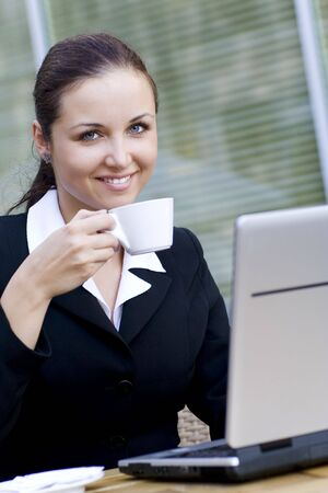 Woman with laptop drinking coffee Stock Photo - 3453788