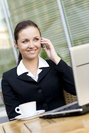 Woman using laptop outdoors Stock Photo - 3453792