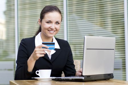 Woman with laptop and credit card photo
