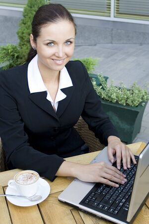 Woman using laptop outdoors Stock Photo - 3453799