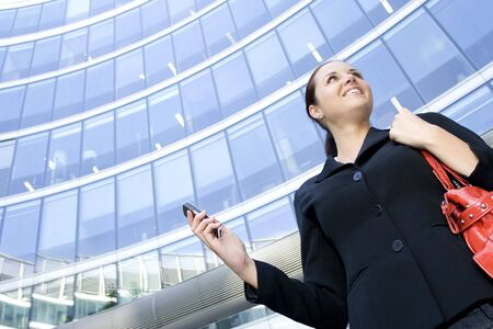 Businesswoman outside a modern office building photo