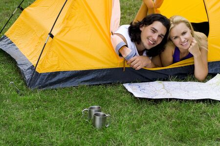 Couple Reading Map in Tent photo
