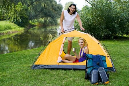 pitching: Couple pitching tent