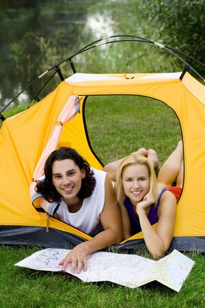 Couple Reading Map in Tent Stock Photo - 3479681
