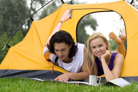 Couple Reading Map in Tent Stock Photo - 3498740