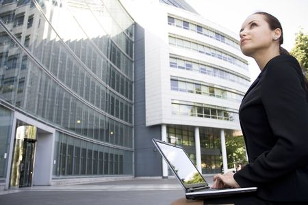 Businesswoman using laptop outside office Stock Photo - 3498838